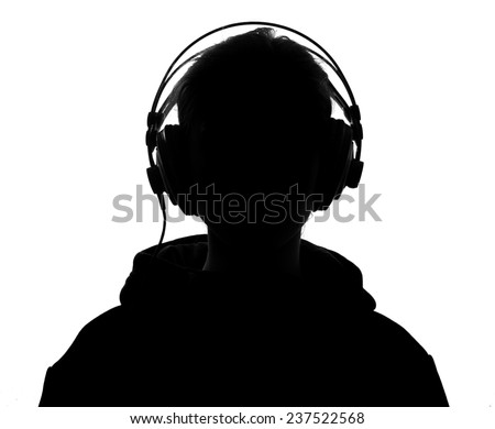 Female silhouette with headphones.Isolated on white background - stock photo