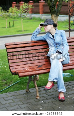 Female sitting on a bench in park