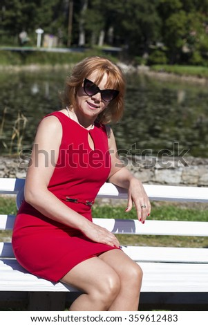 Female sitting on the bench with sunglasses
