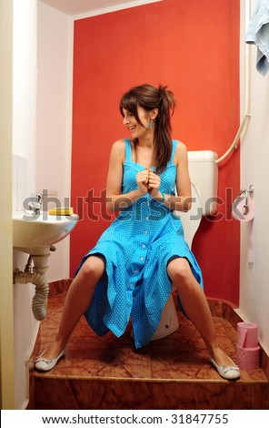 female sitting on the toilet seat