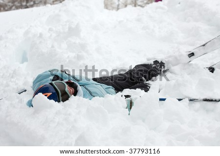 Female skier fallen into deep snow