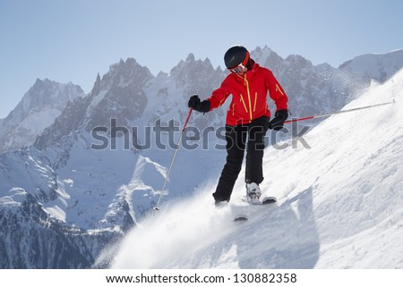 Female skier in front of mountains in Chamonix, France.