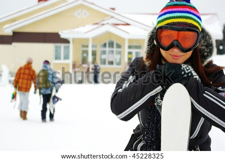Female skier sitting on the bench - stock photo