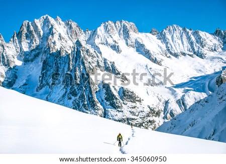 Female skier with beautiful mountain panorama - stock photo