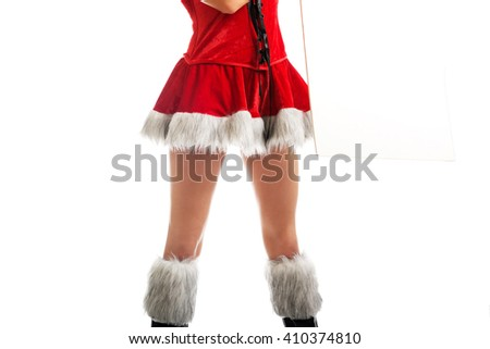 Female slim legs in santa boots - stock photo