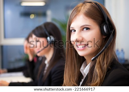 Female smiling customer support operator with headset portrait