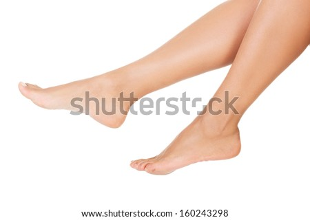 Female smooth feet and legs. Closeup. isolated on white.  - stock photo