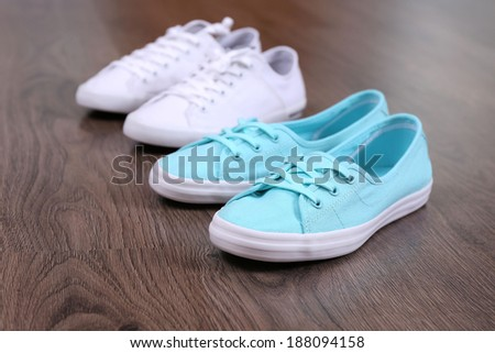Female sneakers on floor