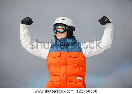 female snowboarder against sun and sky - stock photo