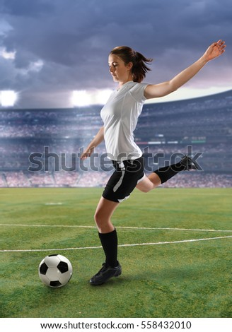 Female soccer player in action in large stadium