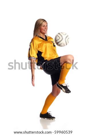 Female soccer player on white - stock photo