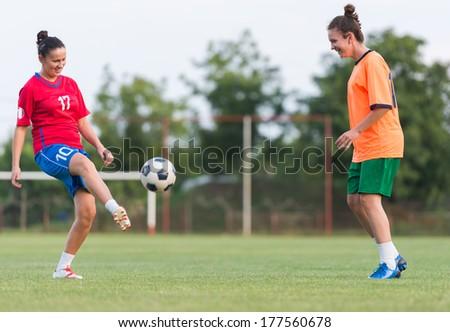Female soccer training in field - stock photo