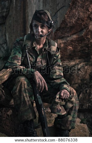female soldier operating in the darkness of jungle