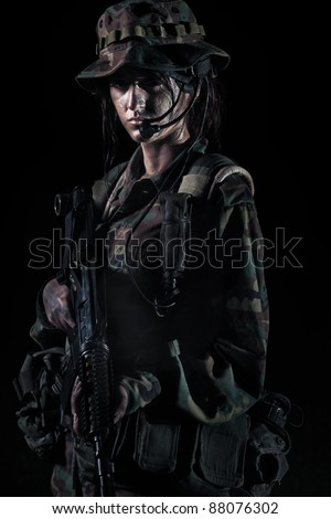 female soldier portrait on black - stock photo