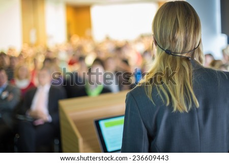Female speaker at Business Conference and Presentation. Audience at the conference hall. Business and Entrepreneurship. Business woman.