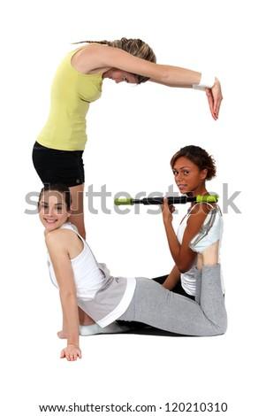 female sporty trio - stock photo