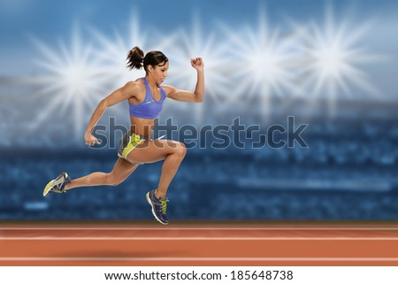 Female sprinter running in stadium