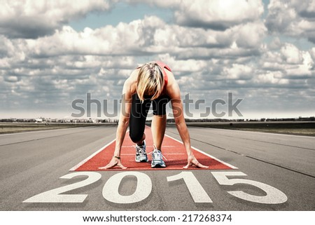 Female sprinter waiting for the start on an airport runway.In the foreground perspective view of the  date 2015. - stock photo