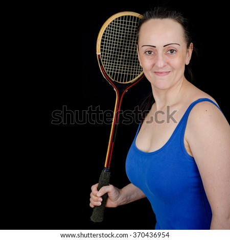 Female Squash player holding racket. Black background with copy space. - stock photo