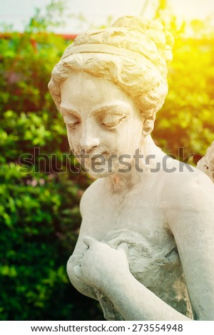 Female statue made of marble. Decorative gardens. Vintage filter. - stock photo