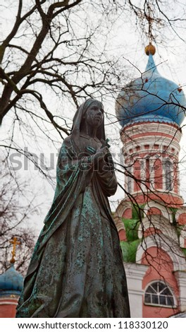 Female statue on cemetery. Necropolis of Donskoy monastery, Moscow, Russia - stock photo