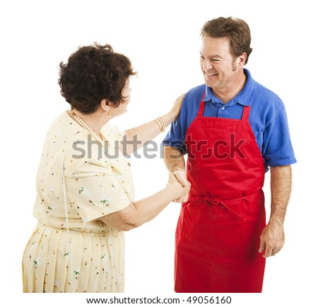 Female store owner congratulates one of her sales clerks.  Isolated on white. - stock photo