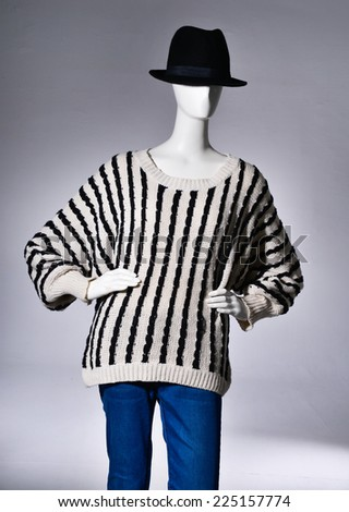 female striped dress clothing in black hat on mannequin - stock photo