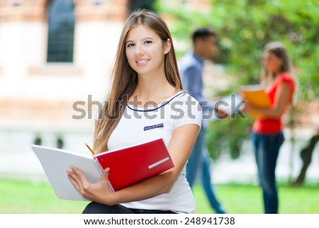 Female student at the park - stock photo