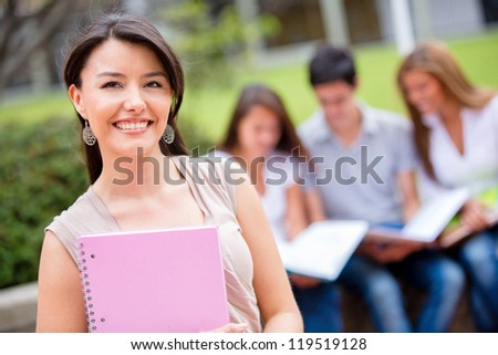 Female student at the university looking very happy