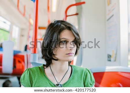 Female student commuting by public transportation - stock photo