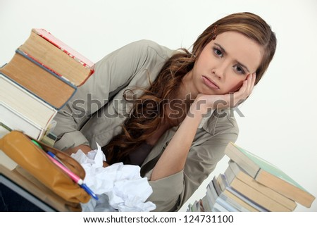 female student fed up with studying - stock photo