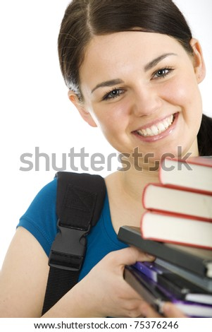 Female student  holding books and smiling - stock photo