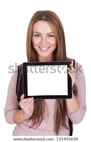 Female Student Holding Digital Tablet Over White Background