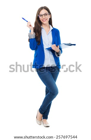 Female student holding pen and clipboard  - stock photo