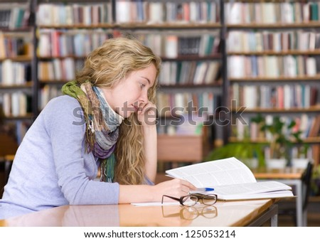 female student in library. - stock photo