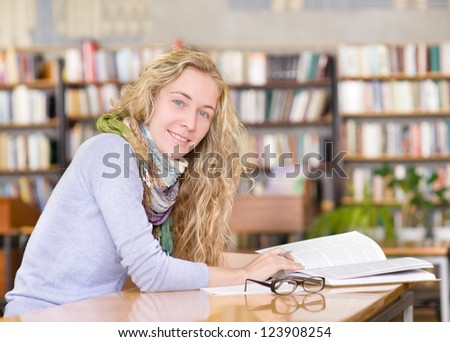 female student in library. looking at camera