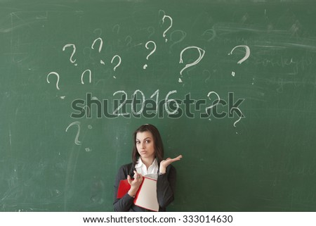 Female student of the board expressed surprise,  chalk drawn date in 2016, a difficult choice future profession to graduates