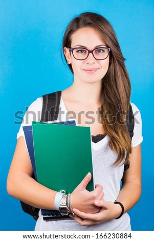 Female Student Portrait on Blue - stock photo