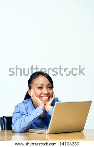 Female student smiles at the camera as she holds her face in her hands. Vertically framed photograph - stock photo
