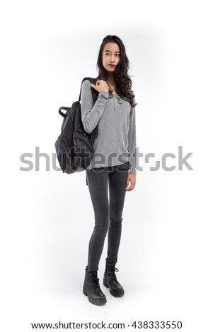 Female student with a backpack on white background - stock photo