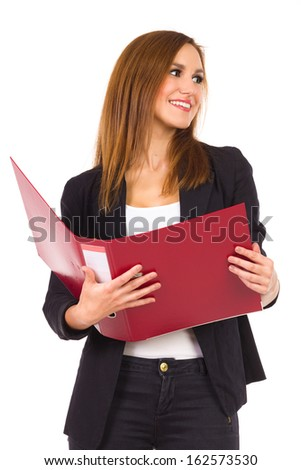 Female Student with ring binder. Business woman holding red ring binder and looking away. Three quarter length studio shot isolated on white.