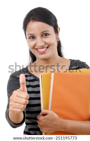 Female student with thumbs up gesture