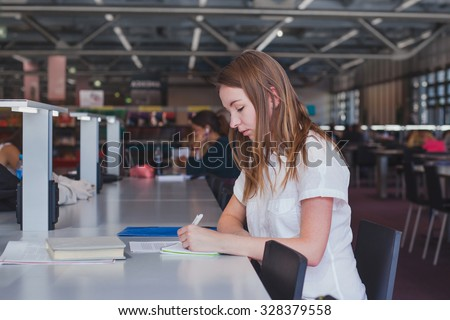 female student working in the library - stock photo