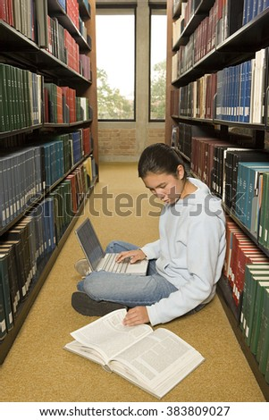 Female student working in the library