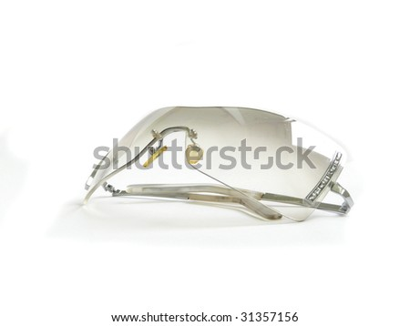 Female sunglasses, isolated over white.