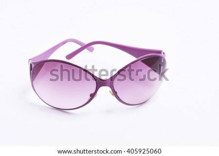 Female sunglasses on white isolated background, purple pink fashion glamorous sunglasses for the eyes - stock photo