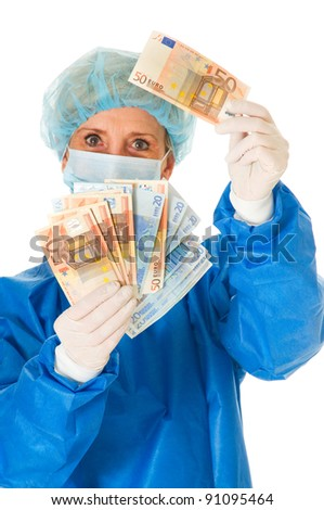 female surgeon holding banknotes - stock photo