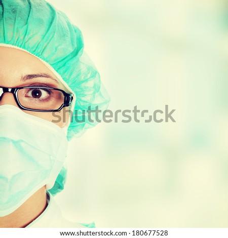 Female surgeon or nurse wearing protective uniform  - stock photo