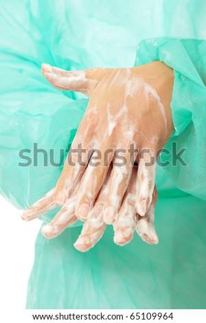 Female surgeon washing her hands - stock photo