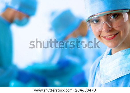 Female surgery in the operating room - stock photo
